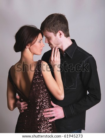 Portrait of a young handsome couple dancing