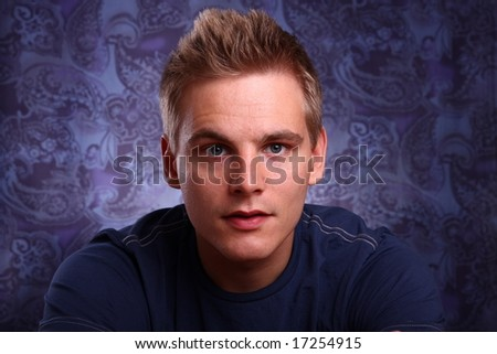 Portrait of a young handsome man in studio