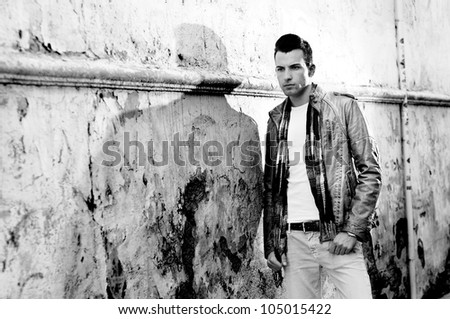 Portrait of a young handsome man in urban background - stock photo