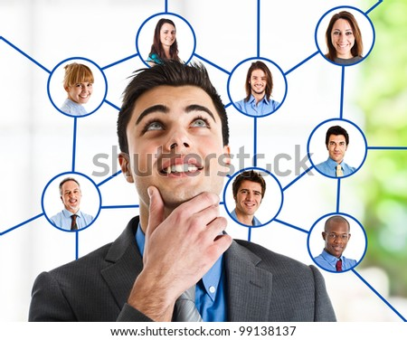 Portrait of a young handsome man looking at his social network - stock photo