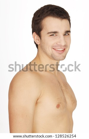 Portrait of a young handsome smiling man on a white background