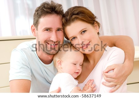 Portrait of a young happy family with the kid