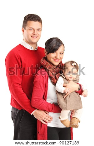 Portrait of a young happy family with the kid isolated on white background