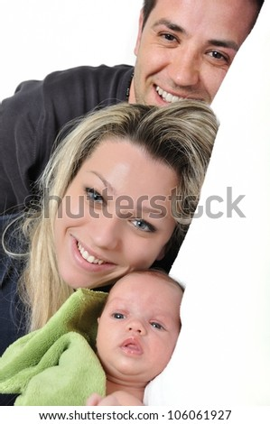 Portrait of a young happy family with the kid on a white background