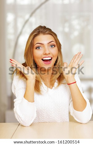 Portrait of a young happy surprised woman