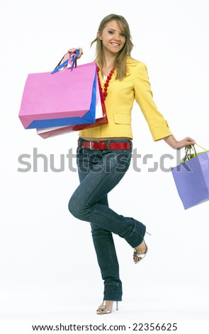 Portrait of a young happy woman with shopping bags