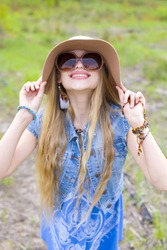 Portrait of a young hippie girl outdoors