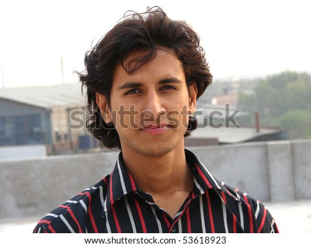 portrait of a young indian man looking with confidence