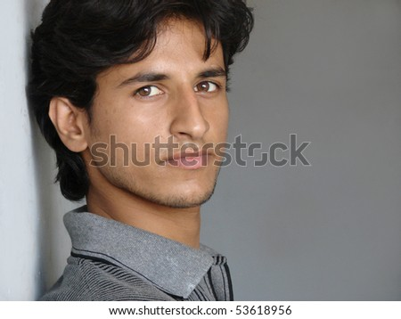 portrait of a young indian man looking with peace