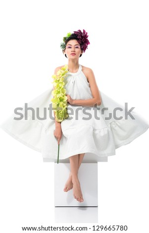 Portrait of a young lady having lots of flowers