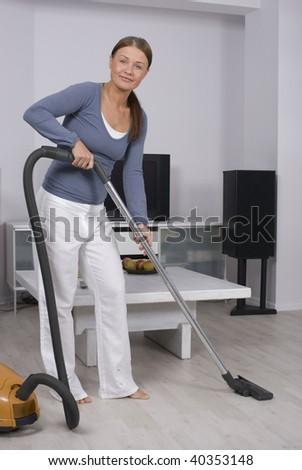 Portrait of a young lady in cleaning a living room floor