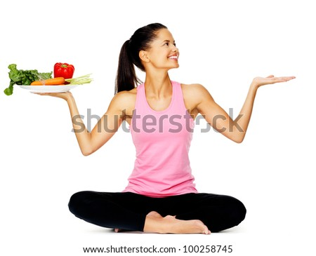 portrait of a young latino woman with fresh vegetables on a plate, healthy eating lifestyle
