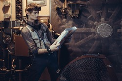 Portrait of a young mad scientist traveler in a steampunk style suit with a card in the background of scenery with gears.
