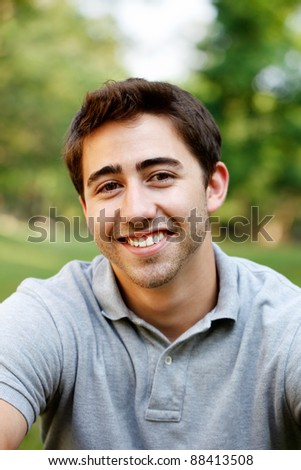 Portrait of a young man at a park