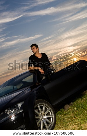 portrait of a young man at the car