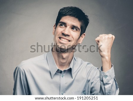 portrait of a young man celebrating being a winner