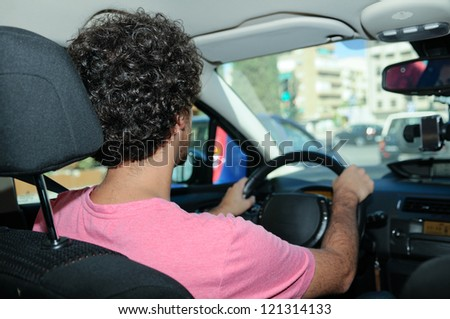 Portrait of a young man driving a car