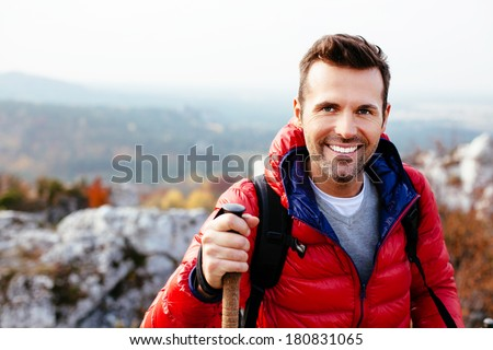 Portrait of a young man hiking in the mountains #180831065