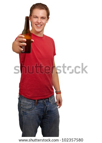 portrait of a young man holding a beer over a white background
