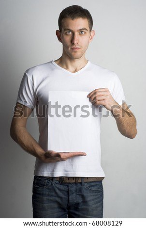 Portrait of a young man holding a blank board for text