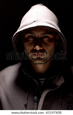 Portrait of a young man in a hood