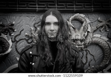 Portrait of a Young Man in a Leather Coat Jacket for a Stroll in St. Petersburg October 11, 2012
