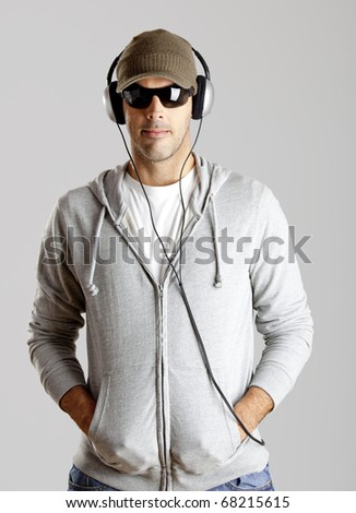 Portrait of a  young man listen music with headphones