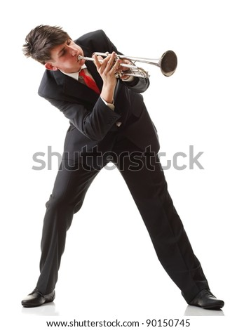 Portrait of a young man playing his Trumpet plays isolated white background
