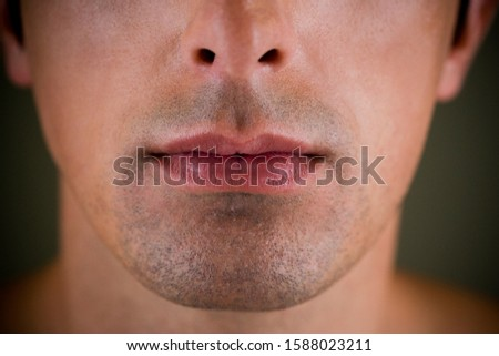 Portrait of a young man's mouth and jaw line