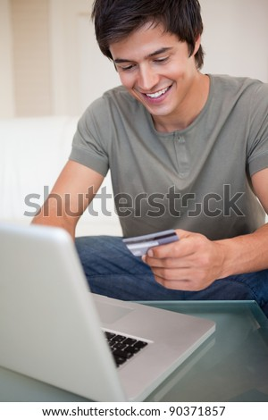Portrait of a young man shopping online in his living room