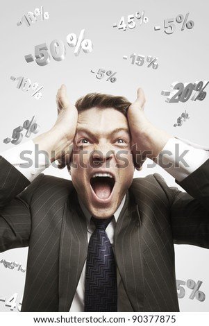 Portrait of a young man shouting loud under falling percents signs above his head. Discount concept depicting percentage symbols falling on man. On a gray background