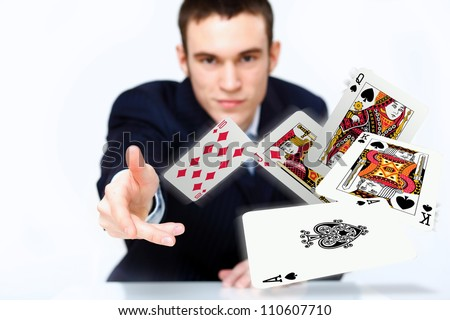Portrait of a young man showing poker cards