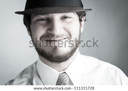 Portrait of a young Man smiling directly to the Camera