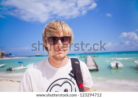 Portrait of a young man standing on the beach