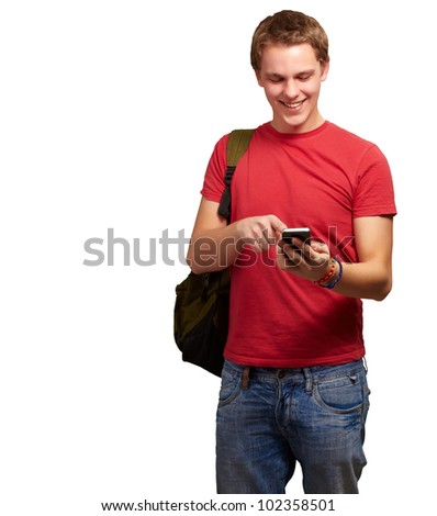 portrait of a young man touching a mobile screen over a white background