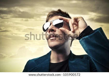 Portrait of a young man wearing fashion sunglasses