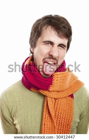 Portrait of a young man wearing scarf and green pullover against white background