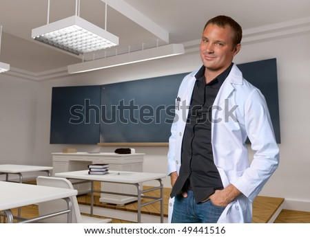 Portrait of a young man with a white robe in a classroom