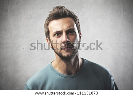 Portrait of a young man with aggressive expression
