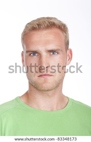 portrait of a young man with blond hair and blue eyes - isolated on white