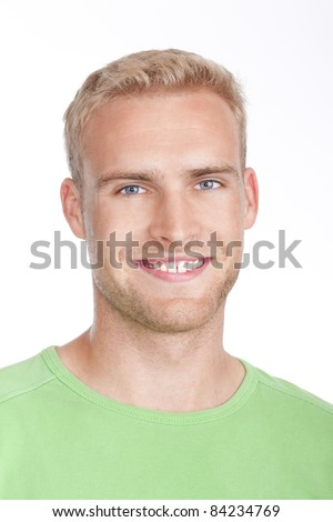 portrait of a young man with blond hair smiling - isolated on white - stock photo