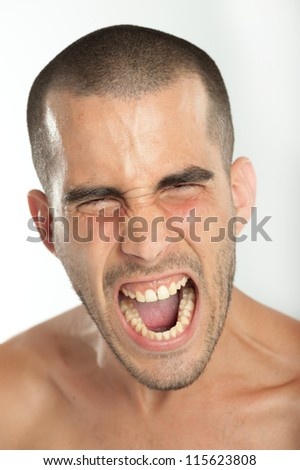 Portrait of a young man yelling