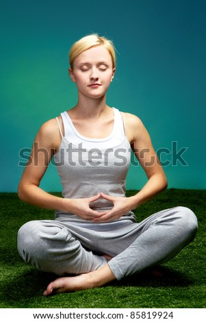 Portrait of a young meditating woman