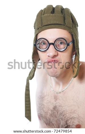 Portrait of a young nerd in funny glasses and tankmans helmet isolated on white