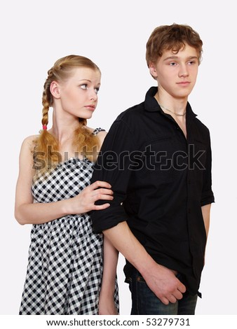 Portrait of a young people. Young couple in problems. Shot in studio.