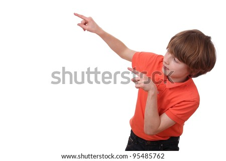 Portrait of a young pointing boy isolated on white background