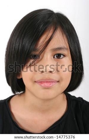 Portrait of a young pretty Eurasian Chinese girl in a black T-shirt