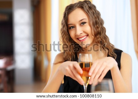 Portrait of a young pretty woman sitting in restaurant