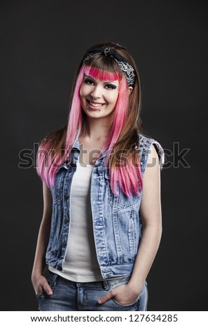 Portrait of a young punk girl with a nice hair cut in pink