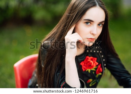a8ced58f2 Portrait of a young punk rock fashion girl wearing black leather jacket  with studs in urban